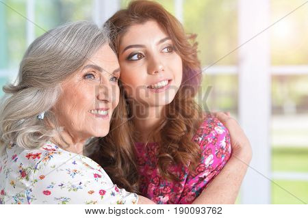 Portrait of a senior woman hugging her daughter