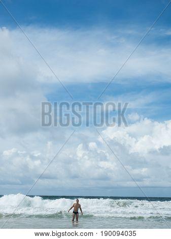 Man in the Indian Ocean. Waves of the Indian Ocean