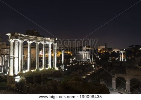 Ancient ruins at forum romanum in Rome at night Italy