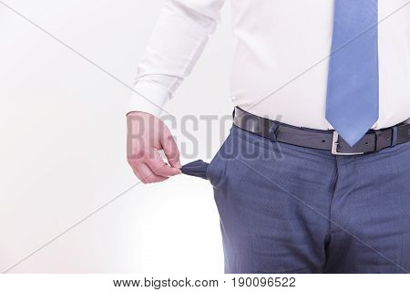 Concept of bankruptcy. Businessman turns out an empty pocket