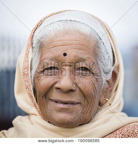 KATHMANDU NEPAL - OCTOBER 05 2016 : Portrait old women in traditional dress in street Kathmandu Nepal
