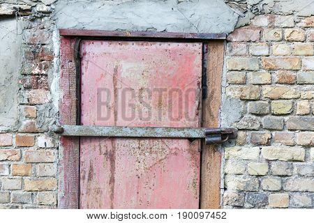 metal door in garage brick wall background