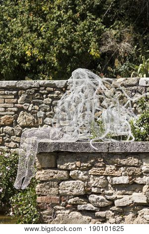 BAGNO VIGNONI, ITALY - JUNE 3 2017: Riflessi sculpture by Daniela Capaccioli in the medieal town of Bagno Vignoni in Tuscany Italy transparent metal wires sculptures