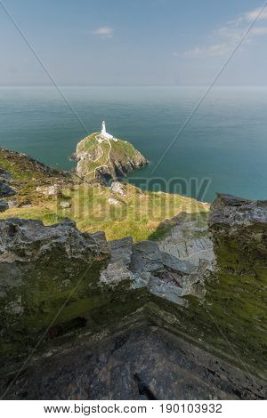 View down on South Stack light house on sunny morning from WWII coastal observation post South Stack. Anglesey North Wales United Kingdom.