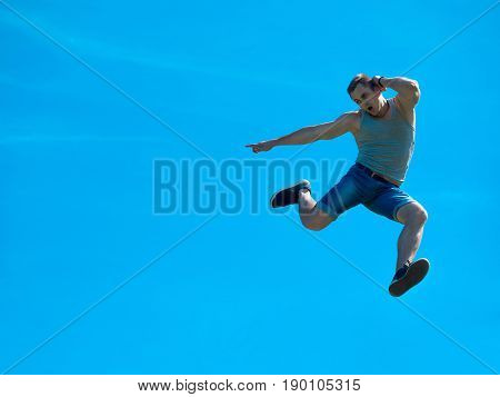 Jumping up guy. Background blue sky. Free fall