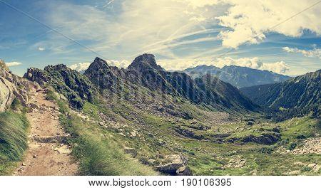 Mountain trail crossing a ridge. Trekking in Brenta Dolomites, Italy.