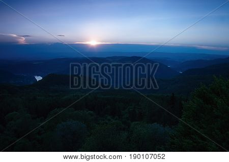 Meander of european river Labe from metal lookout Varhost in spring evening after sunset in czech tourist area named Ceske Stredohori