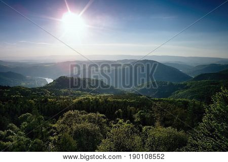 Meander of european river Labe from metal lookout Varhost in spring evening sunset in czech tourist area named Ceske Stredohori