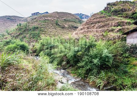 Water Stream Between Terraced Hills Of Dazhai