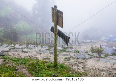 Waymark On Mountain Path In Misty Spring Day