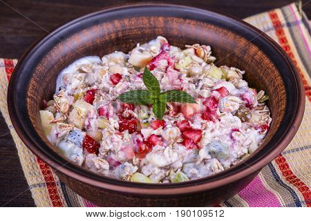 Muesli with lots of dry fruits nuts berries and grains close up