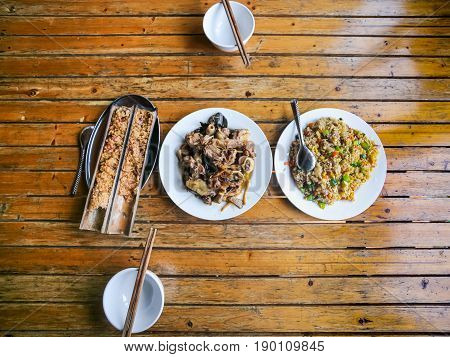 Top View Of Served Chinese Dinner In Rustic Eatery