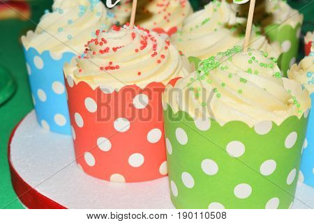 Cup Cakes With Cream And Various Colorful Decorations