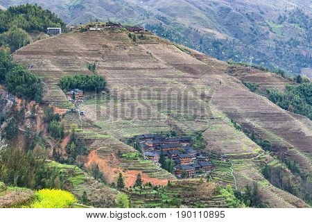 View Of Houses In Village On Slope Of Hill