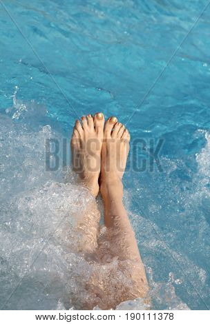 Barefoot Woman In The Pool Of The Spa