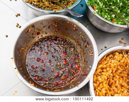 Above View Of Bowl With Spicy Sauce On Kitchen
