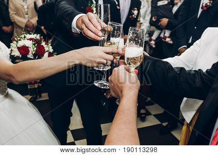 People Toasting With Champagne Glasses At Wedding Reception, Hands Holding Champagne Drinks And Chee