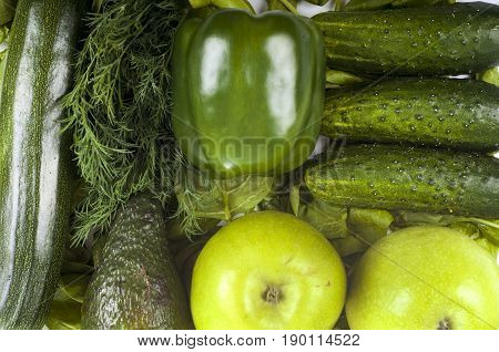 Fresh organic green vegetables - cucumber parsley paprica apple and zucchini. Healthy food background
