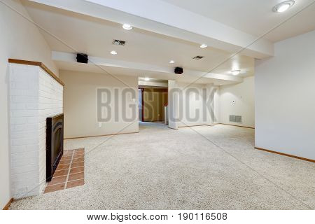White Empty Basement Room With Fireplace