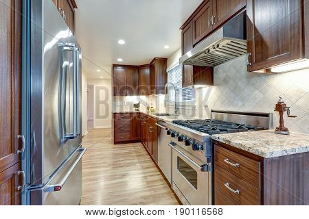 Classic Kitchen With Brown Cabinets, Granite Counters