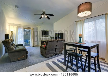 Dining And Living Room Interior With Vaulted Ceiling