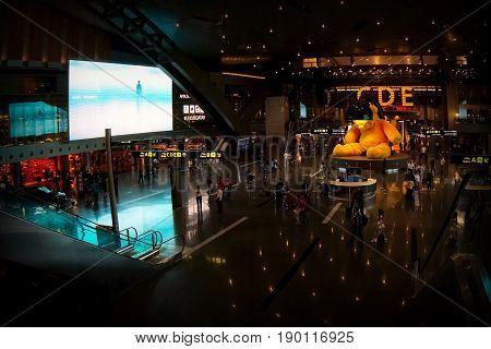 Qatar,  Doha Hamad International Airport - October 2015: passengers in the transit zone Airport