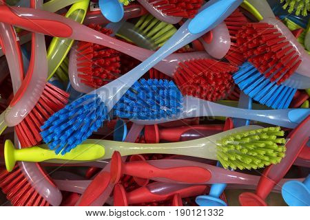 Multi colored plastic brushes for cleaning purposes