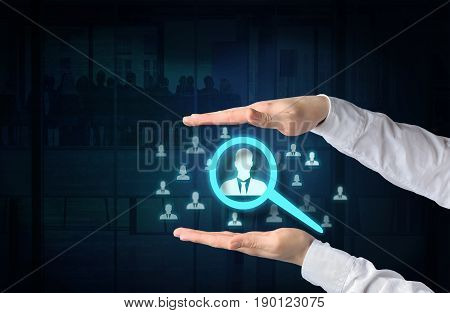 Human resources and customer care concept. Protecting gesture of businessman and symbol of a gloving icons representing group of people over business background.