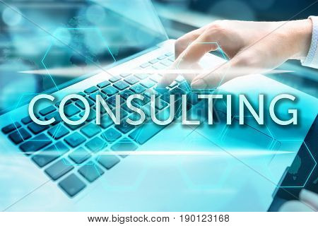 Consulting concept. Woman's hand using computer keyboard with related keywords and signs over business background.