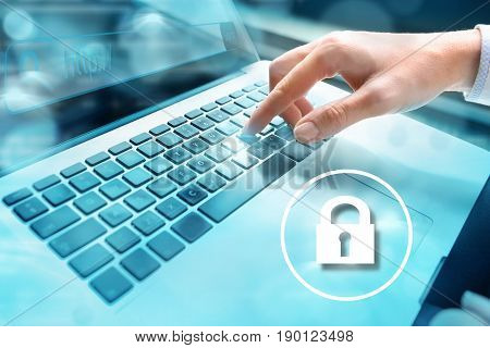 Closeup of businesswoman hand using computer laptop keyboard with written in search bar on virtual screen and locker icon in the foreground:. Internet security concept. Data security.