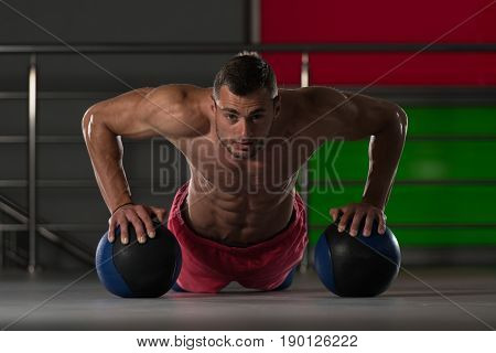 Personal Trainer Doing Push-ups With Ball