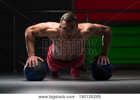 Pushups With Medicine Ball