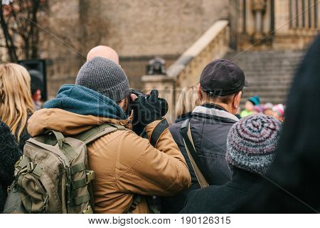 Photographer takes a photo in a crowd. Paparazzi