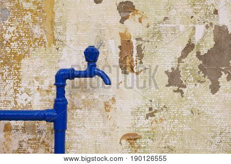 Blue Tap And Pipes On Grunge Wall
