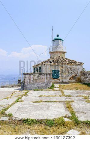 Lighthouse in old Byzantine fortress in Kerkyra, Corfu island in Greece.