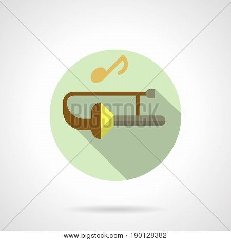 Abstract symbol of trombone and golden note. Brass wind instruments for jazz music. Round flat design vector icon.