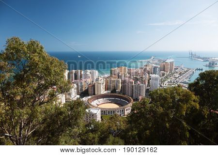 View of the city of Malaga, with the Bullring of La Malagueta and the Port.