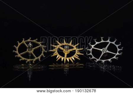 Watch Parts: Variety of Escape Wheels on Black Background