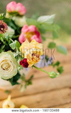 wedding, gardening, floral design, decoration, celebration concept - in beautiful wedding bouquet creamy avalanches and bright yellow roses stand out from other flowers