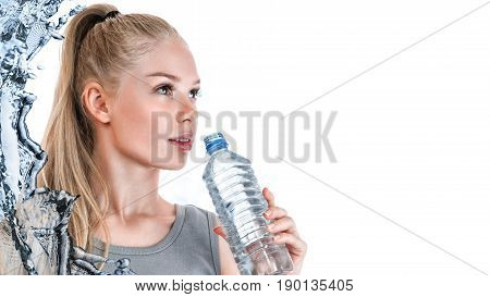 Young slender woman with plastic water bottle isolated over white background