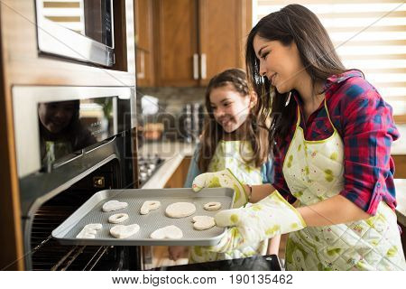 Mom And Girl Baking Together