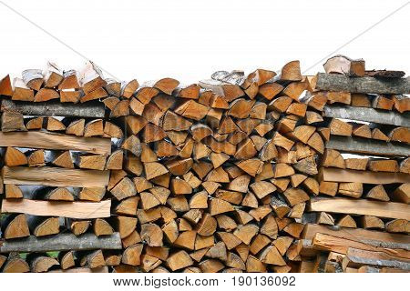 Stack of firewood. big pile of firewood for the furnace, the background.