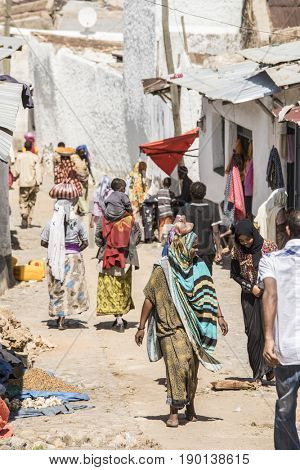 HARAR, ETHIOPIA-MARCH 31, 2017: Unidentified people walk down a street in the ancient city of Harar, Ethiopia