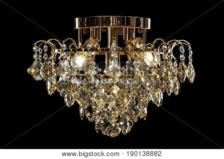crystal chandelier isolated on black background. Luxury royal expensive chandelier for living room.