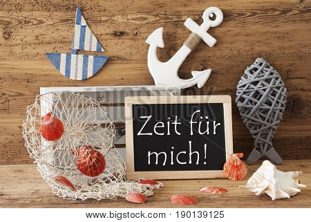 Blackboard With Nautical Summer Decoration And Wooden Background. German Text Zeit Fuer Mich Means Time For Me. Fish, Anchor, Shells And Fishnet For Maritime Contex.