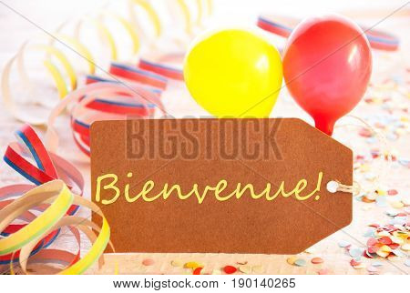 One Label With French Text Bienvenue Means Welcome. Party Decoration Like Streamer, Confetti And Balloons. Wooden Background With Vintage, Retro Or Rustic Syle