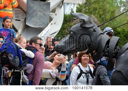 MONTREAL QUEBEC CANADA 19 05 17: Giants Xolo dog walking in the street of Montreal for the 375e anniversary of the city, by Royal De Luxe company Nantes France