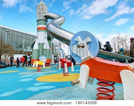 VDNKH, MOSCOW, APR,23, 2017: Incredible unusual fantastic colorful space aerospace childred playground with USSR famous rockets VOSTOK, SOUZ with slides, dog Belka, lunar rover Lunokhod entertainment