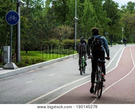 People ride bicycles on the territory of the sports complex Luzhniki in Moscow.