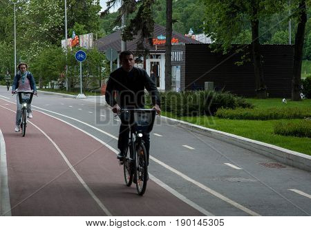 MOSCOW RUSSIA - June 04 2017 People ride bicycles on the territory of the sports complex Luzhniki in Moscow.